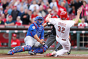 CINCINNATI, OH - APRIL 30: Jay Bruce #32 of the Cincinnati Reds slides at home plate ahead of the tag by Welington Castillo #5 of the Chicago Cubs in the first inning of the game against at Great American Ball Park on April 30, 2014 in Cincinnati, Ohio. (Photo by Joe Robbins) *** Local Caption *** Jay Bruce;Welington Castillo