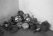 CAMBODIA. Chom Chao (Phnom Penh). 13/01/2011: Kitchen gear in room of Tim Thavy, recently hired garment factory worker, 29 yrs old, from Kampot province. She shares with 6 other people.