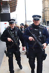 Two armed police patrol near Parliament Square,  after it was announced that following the Boston Marathon bombings in the USA yesterday April 15, security for the upcoming London Marathon, and Lady Thatcher's funeral tomorrow would be reviewed, London, UK,  April 16, 2013, Photo by: Max Nash / i-Images