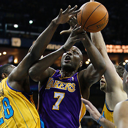 February 5, 2011; New Orleans, LA, USA; New Orleans Hornets center D.J. Mbenga (28) and center David Andersen (11) defend against Los Angeles Lakers power forward Lamar Odom (7) during the second quarter at the New Orleans Arena.   Mandatory Credit: Derick E. Hingle