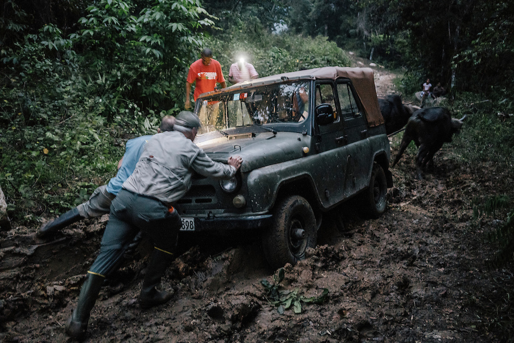 After the jeep got stuck in the mud and the battery died, oxen were used to pull the vehicle out with the help of pushing from Martjan Lammertink and Tim Gallagher, which lasted into the night.