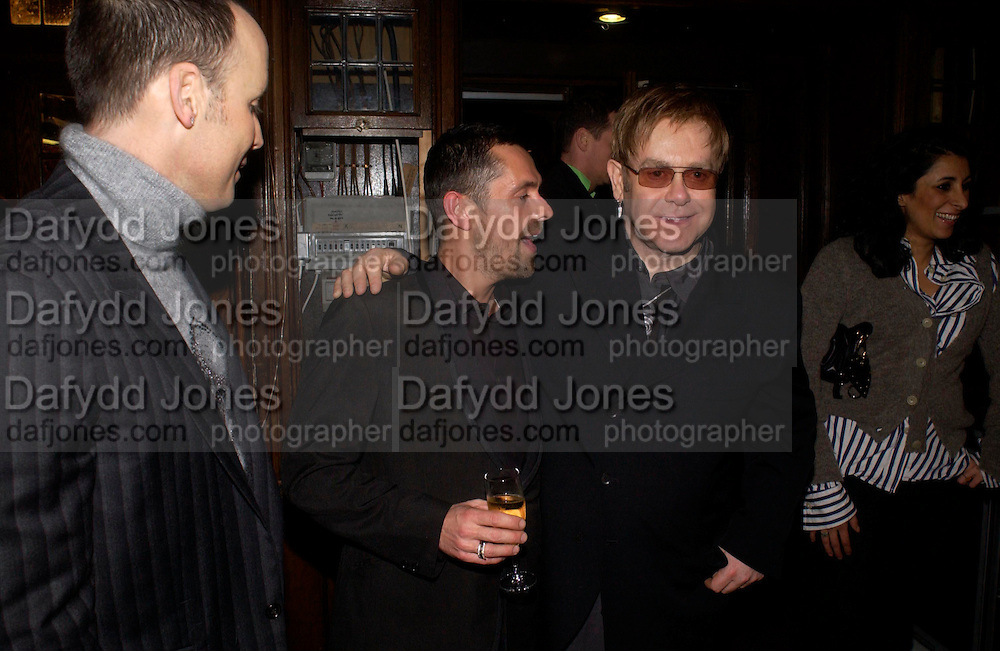 David Furnish, Shaun Leane and Sir Elton John and  . Party hosted by Isabella Blow in honour of Shaun Leane to celebrate his jewelry collection. Liberty's. London. 8 December 2004. ONE TIME USE ONLY - DO NOT ARCHIVE  © Copyright Photograph by Dafydd Jones 66 Stockwell Park Rd. London SW9 0DA Tel 020 7733 0108 www.dafjones.com