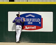 Kansas State right fielder Joe Roundy watches Jayhawks Justin Ellrigh's two run homer go over the wall in the top of the eighth inning.  The Wildcats held on to beat Kansas 5-4 at Tointon Stadium in Manhattan, Kansas, April 23, 2006.