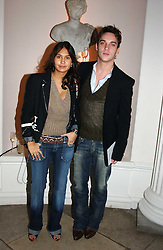 A party hosted by Mario Testino, Bianca Jagger and Kenneth Cole in collaboration with UNFPA and Marie Stopes International to celebrate the publication of Women to Woman: Positively Speaking - a book to raise awareness of women living with HIV/Aids, held at The Orangery, Kensington Palace, London on 2nd December 2004.<br />Picture shows:-Actor JONATHAN RHYS-MEYERS and REENA HAMMER<br /><br /><br />NON EXCLUSIVE - WORLD RIGHTS