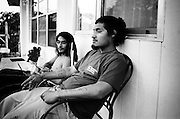 Two young men, Pompano Beach, Florida. There were at least four foreclosed homes on their block.