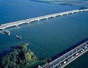 Nederland, Zuid-Holland, Hollandsch Diep, 17-10-2003; nieuwe Moerdijkbrug voor de HSL (hogesnelheidslijn) is nagenoeg volooid; de nieuwe brug ligt voor de bestaande spoorbrug; onder in beeld de brug voor autoverkeer (A16), rechtsboven Noord-Brabant; verkeer en vervoer, transport, infrastructuur, bouwen, spoor, rail, planologie ruimtelijke ordening, landschap; DEEL VAN EEN SERIE OVER  INFRASTRUCTUUR (zie ook eerdere en andere (lucht)foto's)..Foto Siebe Swart