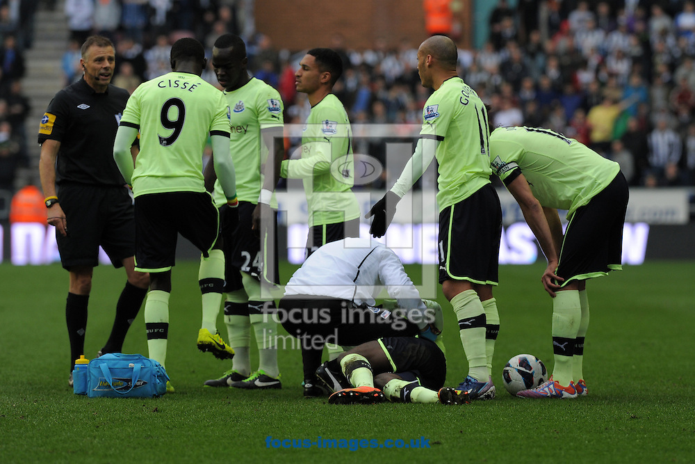 Picture by Alan Wright/Focus Images Ltd 07733 196489.17/03/2013.Newcastle United players remenstrate with referee Mark Halsey after Massadio Haidara injury during the match against Wigan Athletic in the Barclays Premier League at the DW Stadium, Wigan.