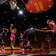 10 February 2018: The San Diego State Aztecs women's basketball team hosts Nevada on Play4Kay day at Viejas Arena. San Diego State Aztecs guard Te'a Adams (5) lays the ball up in between Nevada Wolf Pack defenders in the second half. The Aztecs beat the Wolfpack 75-72. <br /> More game action at www.sdsuaztecphotos.com