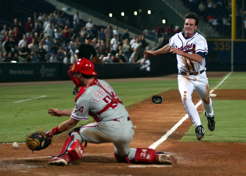 Philadelphia Phillies' Mike Lieberthal catches the ball as Atlanta Braves' Ryan Langerhans tries to make it to home plate at Turner Field in Atlanta.