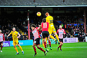 Troy Brown, Arron Davies are out jumped by  Rory Gaffney during the Sky Bet League 2 match between Exeter City and Bristol Rovers at St James' Park, Exeter, England on 28 November 2015. Photo by Graham Hunt.