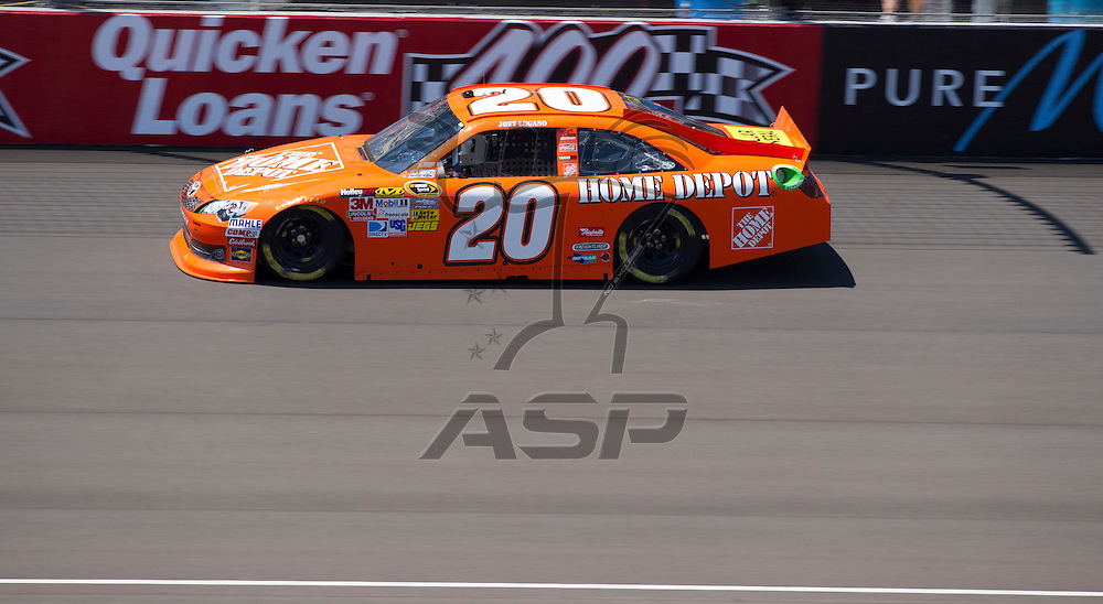 Brooklyn, MI - JUN 15, 2012: Joey Logano (20) during practice for the Quicken Loans 400 race at the Michigan International Speedway in Brooklyn, MI.