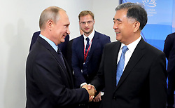 September 6, 2017 - Vladivostok, Primorye Territory, Russia - September 6, 2017. - Russia, Primorye Territory, Vladivostok. - Russian President Vladimir Putin and Vice Premier of the State Council of the People's Republic of China Wang Yang (right) during a meeting as part of the 3rd Eastern Economic Forum hosted by the Far Eastern Federal University, Russky Island. (Credit Image: © Russian Look via ZUMA Wire)