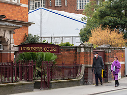 © Licensed to London News Pictures. 18/03/2020. London, UK. A man in a medical mask walks past a makeshift mortuary which has been put up behind Westminster Coroners Court in Horseferry Road as the Coronavirus pandemic crisis continues. Photo credit: Alex Lentati/LNP