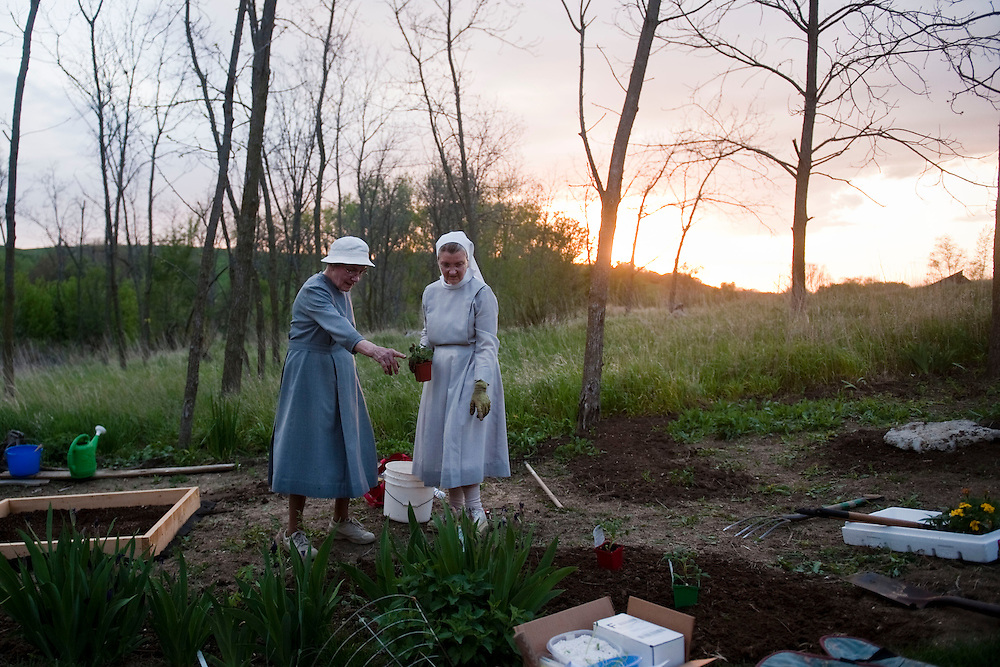 Sister Anne, right, and Sister Francis, garden together at the Sister's home, May 20, 2014. (Photo by Lauren Justice)
