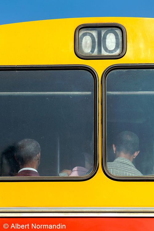 Back of bus windows with double zero numbers and passengers, Addis Ababa, Ethiopia, Africa