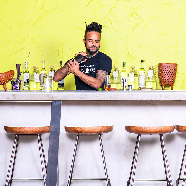 Baltimore, Maryland - December 18, 2017: Dre Barnhill, the head bartender at Clavel makes a Amado Nervo, with cilantro honey, mezcal, vermouth from Priorat, Lime, and cava. <br /> CREDIT: Matt Roth