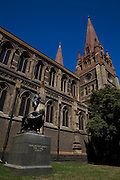 St. Paul's Cathedral, Melbourne, Australia, is an Anglican cathedral designed by various architects,  William Butterfield, John Barr and Joseph Reed. In the foreground is a stature of Captain Matthew Flinders, explorer. Editorial use only.