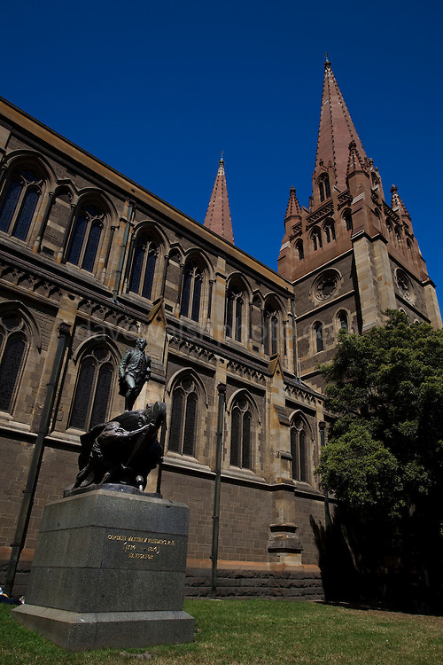 St. Paul's Cathedral, Melbourne, Australia, is an Anglican cathedral designed by various architects,  William Butterfield, John Barr and Joseph Reed. In the foreground is a stature of Captain Matthew Flinders, explorer.