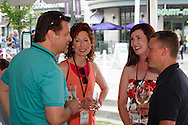 (from left) Mark Poeschl of Cargill, Nancy Poeschl, Marianne Requarth of Cincinnati Children's and Jay Requarth of Welcome to College during the 6th Annual Clambake for Kids' Sake benefiting Big Brothers Big Sisters of the Miami Valley at The Greene, Saturday, June 22, 2013.
