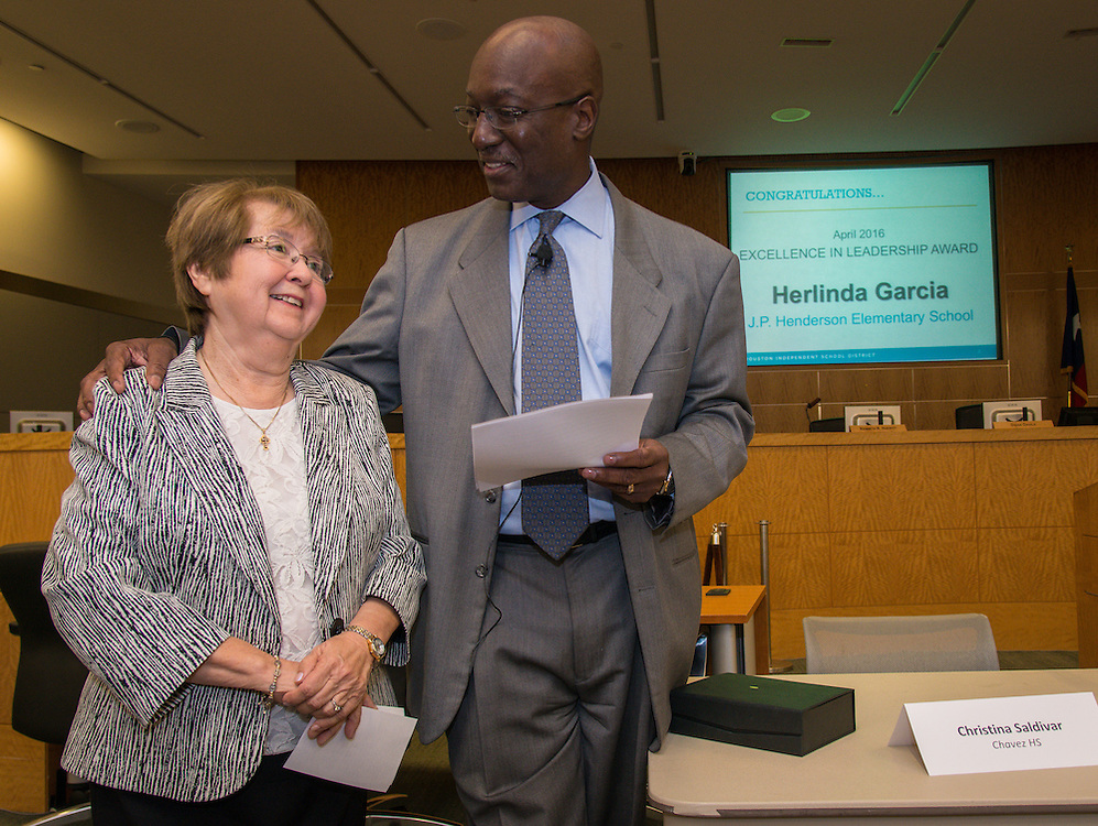 Interim Superintendent Ken Huewitt presents Herlinda Garcia, left, with a leadership award during a Professional Leadership Series meeting, April 6, 2016.