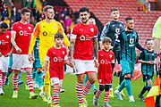 Barnsley midfielder Alex Mowatt (27) leads the teams out during the EFL Sky Bet Championship match between Barnsley and Swansea City at Oakwell, Barnsley, England on 19 October 2019.