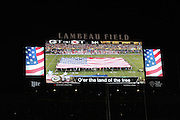 The Lambeau Field scoreboard depicts the display of the American flag on the field during the playing of the National Anthem before the Green Bay Packers 2015 NFL week 3 regular season football game against the Kansas City Chiefs on Monday, Sept. 28, 2015 in Green Bay, Wis. The Packers won the game 38-28. (©Paul Anthony Spinelli)