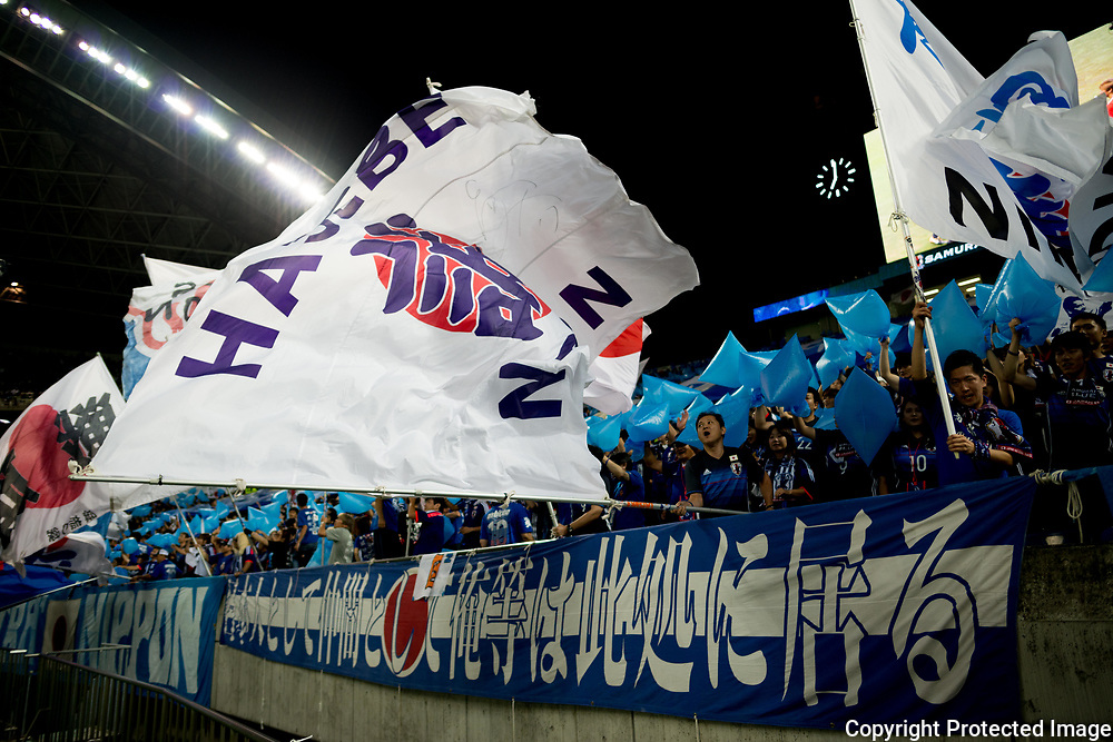 Football Soccer - Japan v Australia - World Cup 2018 Qualifier - Saitama Stadium 2002, Saitama, Japan - 31/08/17.  Japanese supporters hold flags during the match. 31/08/2017-Saitama, JAPAN