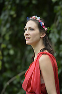 Old Westbury, New York, USA. 28th June 2015. Lori Belilove & The Isadora Duncan Dance Company, dressed in Greek themed tunics and flower wreaths in their hair, give dancing lessons to children throughout the gardens, and then perform at historic Old Westbury Gardens, a Long Island Gold Coast estate, for its Midsummer Night event. A member of the dance company is shown.