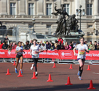 Junior athlete runs past Buckingham Palace and the Victoria Memorial during the junior race as they approach the finish of the Virgin Money London Marathon 2014<br /> on Sunday 13 April 2014<br /> Photo: Dave Shopland/Virgin Money London Marathon<br /> media@london-marathon.co.uk