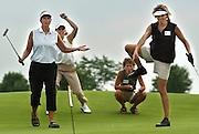 Lori Davis,  left, Jean Arnott, left center, Rachel Robert, right center, and Mary Morgan watch Morgan's birdie putt just miss the hole in the Western DuPage Special Recreation Association Foundation ninth annual women's golf outing at the Naperbrook Golf Course in Naperville, Ill.