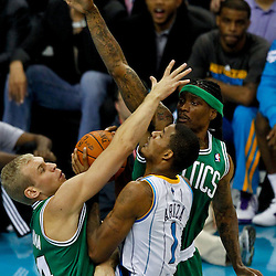 December 28, 2011; New Orleans, LA, USA; New Orleans Hornets small forward Trevor Ariza (1) collides with Boston Celtics center Greg Stiemsma (54) and Marquis Daniels (4) during the first quarter of a game at the New Orleans Arena.   Mandatory Credit: Derick E. Hingle-US PRESSWIRE