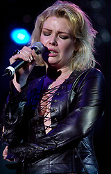 Kim Wilde steps out of the her TV Gardening clothes and Back on Stage to Tour with<br /><br />Steve Starnge (Visage)<br />Claire Grogan (Altered Images)<br />The Belle Stars<br />Dollar<br />Kim Wilde<br />The Human League<br />Play on the Here and Now  Christmas Party Tour at Sheffields Hallam FM Arena Friday 13th December 2002<br /><br />[#Beginning of Shooting Data Section]<br />Nikon D1 <br />2002/12/13 22:40:25.3<br />JPEG (8-bit) Fine<br />Image Size:  2000 x 1312<br />Color<br />Lens: 80-200mm f/2.8-2.8<br />Focal Length: 155mm<br />Exposure Mode: Manual<br />Metering Mode: Spot<br />1/200 sec - f/2.8<br />Exposure Comp.: 0 EV<br />Sensitivity: ISO 800<br />White Balance: Auto<br />AF Mode: AF-S<br />Tone Comp: Normal<br />Flash Sync Mode: Not Attached<br />Color Mode: <br />Hue Adjustment: <br />Sharpening: Normal<br />Noise Reduction: <br />Image Comment: <br />[#End of Shooting Data Section]