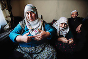 Her parents listen as Safiye Çinar talks about the origins of her extended family. Golden Horn (or Haliç) area, Istanbul, Turkey.
