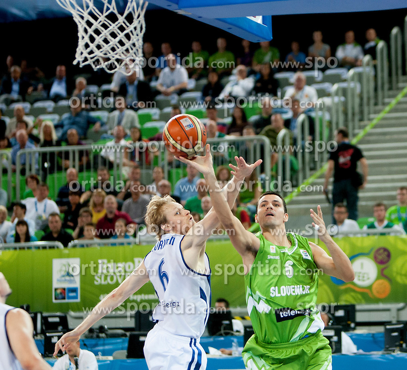Kimmo Muurinen #6 of Finland vs Jure Balazic of Slovenia during basketball match between National teams of Finland and Slovenia in 2nd Round at Day 13 of Eurobasket 2013 on September 14, 2013 in SRC Stozice, Ljubljana, Slovenia. (Photo By Urban Urbanc / Sportida)