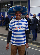 In spite of the depressing weather, this could not hold the excitement of some QPR fans during the Sky Bet Championship match between Queens Park Rangers and Nottingham Forest at the Loftus Road Stadium, London, England on 12 September 2015. Photo by Matthew Redman.