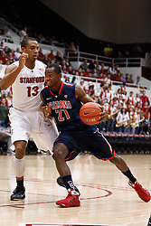 February 3, 2011; Stanford, CA, USA;  Arizona Wildcats guard Kyle Fogg (21) is defended by Stanford Cardinal forward/center Josh Owens (13) during the first half at Maples Pavilion.