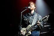 Dan Auerbach of The Black Keys performs on stage at Alexandra Palace on February 9, 2012 in London, United Kingdom.  (Photo by Simone Joyner)