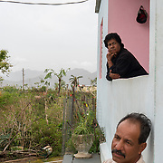 OCTOBER 18 - LAS MARIAS, PUERTO RICO - <br /> Jose Sanchez Acevedo, 52, and his mother Cruz Acevedo Soler, 74, on the front porch of the farm house they live in following the destructive path of hurricane Maria.<br /> (Photo by Angel Valentin for NPR)