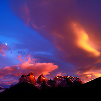 Chile, Torres del Paine National Park, Sunrise lights clouds and Los Cuernos spires with setting moon in Patagonia