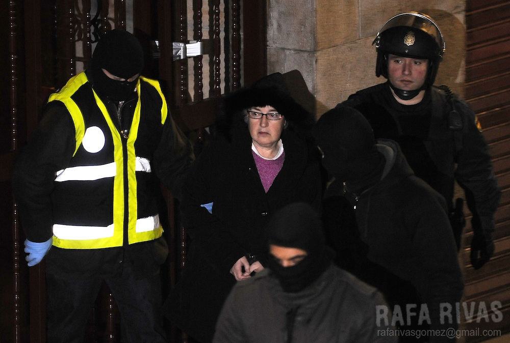 Representative of Basque political party ANV (Basque Nationalist Action), Arantza Urkaregi (C), is arrested by Spanish Police during an operation against ANV ordered by Spanish judge Baltasar Garzon, on January 23, 2009, in the northern Spanish Basque city of Bilbao.
