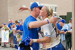 UK first baseman Lauren Cumbess, right, is congratulated by her father Byran Cumbess after her team defeated Virginia Tech, 1-0, in the KY Regional Championship Game of the 2013 NCAA D1 Softball Tournament, Sunday, May 19, 2013 at John Cropp Stadium in Lexington. Photo by Jonathan Palmer