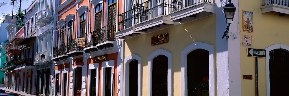 PUERTO RICO, SAN JUAN World Heritage Site, balconied two storied buildings along Calle Christo in the heart of the old city