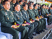 29 SEPTEMBER 2014 - NAKHON NAYOK, NAKHON NAYOK, THAILAND: Senior Thai army officers in the grandstands at the retirement ceremony for more than 200 Thai generals including Gen. Prayuth Chan-ocha, who led the 22 May coup against the civilian government earlier this year. Prayuth has been chief of the Thai army since 2010. After his retirement, Gen. Prayuth will retain his posts as head of the junta's National Council for Peace and Order (NCPO) and Prime Minister of Thailand. Under Thai law, military officers must retire at 60 years of age. The 200 generals who retired with Prayuth were also his classmates at the Chulalomklao Royal Military Academy in Nakhon Nayok.    PHOTO BY JACK KURTZ