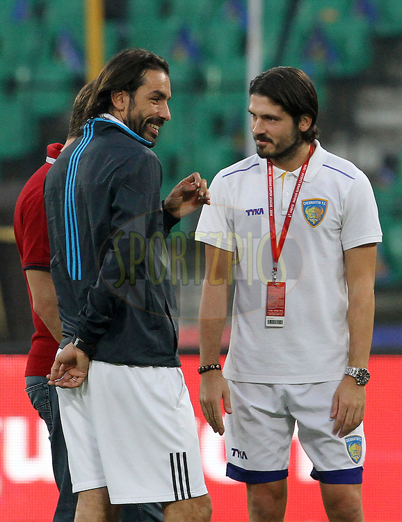 Robert Pires of FC Goa and Bojan Djordjic of Chennaiyin FC during match 50 of the Hero Indian Super League between Chennaiyin FC and FC Goa held at the Jawaharlal Nehru Stadium, Chennai, India on the 5th December 2014.<br /> <br /> Photo by:  Vipin Pawar/ ISL/ SPORTZPICS