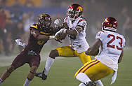 Arizona State University and University of Southern California in a football game on September 26, 2015 in Tempe, AZ.  USC won 42 to 14.  At half, USC led 35 to 0.<br /> <br /> Isaac Whitney (15) defends ball-carrier Jason Lewis (23) from ASU defender Lloyd Carrington (8) early in the second quarter.