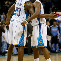 Dec 18, 2009; New Orleans, LA, USA; New Orleans Hornets guard Chris Paul (3) celebrates with guard Devin Brown (23) during the second half against the Denver Nuggets at the New Orleans Arena. The Hornets defeated the Nuggets 98-92. Mandatory Credit: Derick E. Hingle-US PRESSWIRE