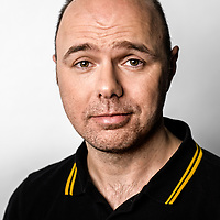 Recently I was commissioned by Curtis Brown Management to capture a series of promotional portraiture for  Karl Pilkington. An English travel show presenter, actor, author and all-round funny man who shot to fame alongside Ricky Gervais and Stephen Merchant with the radio programme, the Ricky Gervais Show. <br /> He then jetted around the world as the face of the hugely successful, An Idiot Abroad, before making his acting debut in the comedy-drama series, Derek. He has also enjoyed prominent success as a radio producer and as the co-founder of RISK productions, a television production company. Meeting Karl at the London studio was an absolute treat. I'd been a great admirer of his programmes for a while and was eager to hear about his experiences.<br /> For anybody familiar with Karl's work, you will be all too informed of his no nonsense persona; a hilariously blunt way of looking at the world, and a rare capability of reducing some of the world's greatest wonders to nothing more than overrated shams.