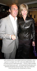 MR ADRIAN GILL and MISS NICOLA FORMBY, at a party in London on 15th January 2002.	OWN 164