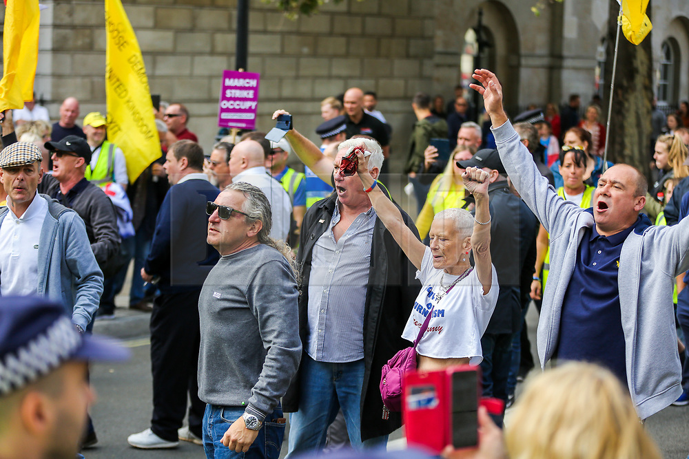 """© Licensed to London News Pictures. 07/09/2019. London, UK. Pro Brexit protesters march in Whitehall as anti-Brexit protesters take part in """"Defend our Democracy and Stop Brexit"""" demonstration in Whitehall, Westminster. The protesters are demonstrating against the British Prime Minister Boris Johnson's intention to prorogue Parliament until 14 October. Photo credit: Dinendra Haria/LNP"""