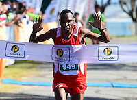 MOSSEL BAY, SOUTH AFRICA - SEPTEMBER 24: Gilbert Mutandiso (949) of Zimbabwe wins the race during the PetroSA Marathon finishing at Santos Caravan Park on September 24, 2016 in Mossel Bay, South Africa. (Photo by Roger Sedres/Gallo Images)